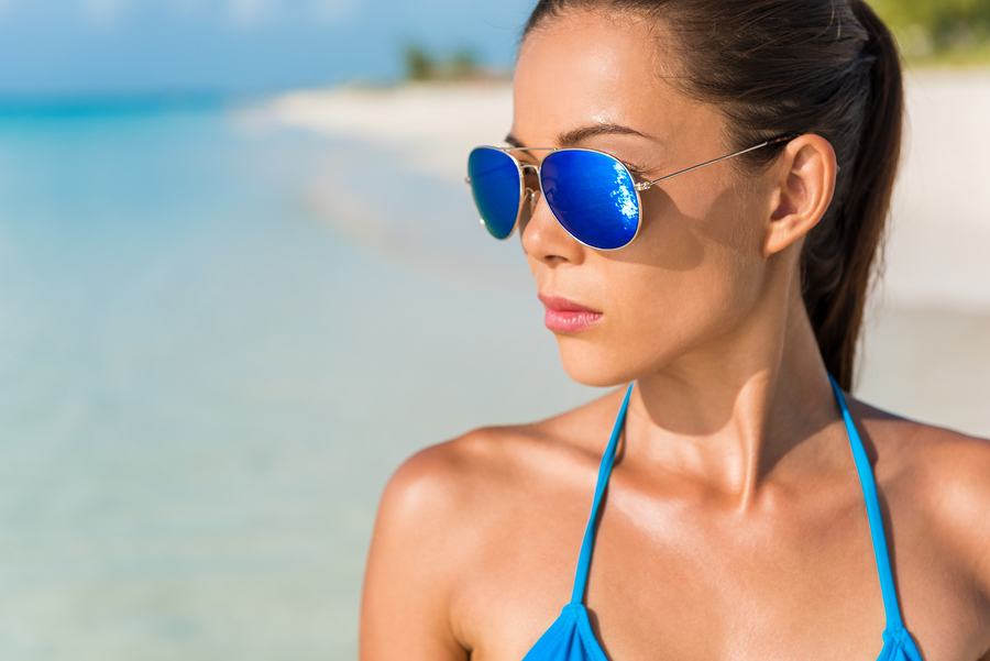 woman at the beach wearing polarized lenses